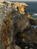 Tourist Atop Craggy Cliffs on Australia's Coast Photographic Print by Mattias Klum