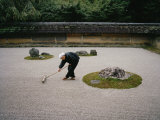 Young Monk Raking the Famous Japanese Rock Garden of Ryoanji Temple Photographic Print by  xPacifica