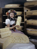 Woman Poses with Large Wheels and Chunks of Swiss Cheese Fotografisk trykk av Joseph Baylor Roberts