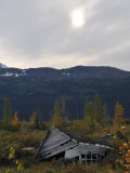 Dilapidated Old Cabin and Mountain Ridges in Scenic Kenai Peninsula Photographic Print by George Herben