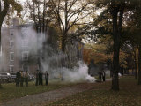 Students Gather by a Leaf Fire Outside a Dormitory at Bowdoin College Photographic Print by B. Anthony Stewart
