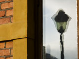Reflection of a Street Light in Window Photographic Print by Mattias Klum