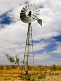 Windmill Being Blown around by the Wind in Outback Australia Photographie par Brooke Whatnall