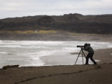Photographer Setting Up a Shot in a Scenic Iceland Location Photographic Print by Mattias Klum