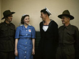 Red Cross Worker Smiles at a Sailor as Other Military Men Look On Photographic Print by Howell Walker
