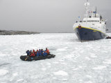 Ecotourists Paddle their Way Through Ice to Palmer Research Station Photographic Print by  Keenpress