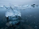 Chunks of Ice Melting in the Water at the Vatnajokull Icefield Photographic Print by Mattias Klum