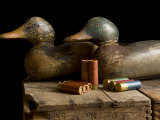Antique Duck Decoys and Shotgun Shells Sit on an Old Wooden Crate Photographic Print by Joel Sartore