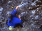Blur of Woman Bouldering across Rocks Photographic Print by Kate Thompson