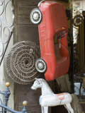 Old Toys for Sale, Metal Red Car, Wooden Horse During Monthly Market Photographic Print by  Keenpress