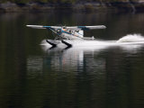 Seaplane Lands in Rudyard Bay Photographic Print by Michael Melford