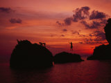 Small Group Slacklining over the Andaman Sea at Sunset Photographic Print by Dawn Kish