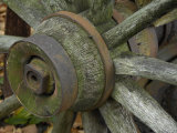 Close View of the Hub of a Weathered Wagon Wheel Photographic Print by Scott Sroka