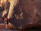 Woman Putting on Her Bouldering Gear Photographic Print by Kate Thompson