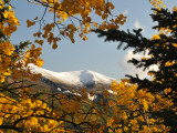 Trees in Fall Colors Frame a Mountain with it&#39;s First Seasonal Snow Photographic Print by George Herben
