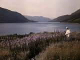 Man Stands Next to Thirlmere Reservoir, a Source of Water for Many Photographic Print by Clifton R. Adams