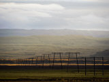 Power Transmission Lines Stretching into the Distance in Iceland Photographic Print by Mattias Klum