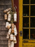 Buoys Hanging Outside the Door Photographic Print by Todd Gipstein
