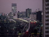 Elevated View of the Bullet Train at Tokyo Station at Twilight Fotografisk tryk af Paul Chesley