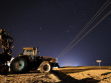Tractor and Power Lines Against the Night Sky in Kansas Photographic Print by Jim Richardson