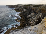 Scenic View of Rocky Cliffs Pounded by Surf on an Australian Shore Photographic Print by Mattias Klum