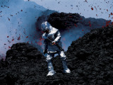 Scientist in a Thermal Suit and Helmet Collects Samples of Lava Papier Photo par Peter Carsten