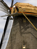 Man Working on the Roof of His Windmill Photographic Print by Mattias Klum
