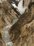 Waterfall Cascading Down a Cliff into the Yellowstone River Below Photographic Print by William Allen