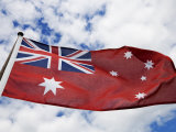 Naval Flag of Australia Flying under a Cloudy Sky Photographic Print by Mattias Klum
