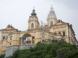 Melk Abbey (German: Stift Melk) in Fog, Low Angle View Photographic Print by  Keenpress