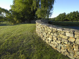 Curved Stone Wall Next to a Closely Cropped Lawn Photographic Print by Scott Sroka