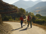 Couple with their Dog Hiking Along the Douro River Photographic Print by Michael Melford