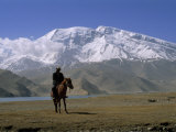 Khyrgiz Nomad Rides by Lake Karakul under 7546M Mustagh Ata Photographic Print by Gordon Wiltsie