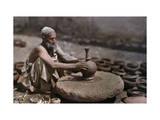 Man Works at His Potter's Wheel Photographic Print by Franklin Price Knott