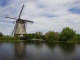 Windmill on a Waterway in Holland Photographic Print by Mattias Klum