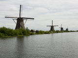 Windmills Along a Waterway in Holland Photographic Print by Mattias Klum