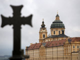 Silhouette of Cross Stands in Front of Melk Abbey Photographic Print by  Keenpress