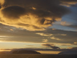 Sunrise and Clouds over a Landscape of Mountains and Sea Photographic Print by  Keenpress