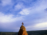 Female Climber at Top of a Rock Spire Photographic Print by Kate Thompson