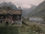 Family Outside their House That Rises Above a Scenic Fjord Photographic Print by Gustav Heurlin