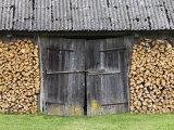 Barn Door Surrounded by Firewood Stacks Photographic Print by  Keenpress