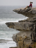 Young Woman Sitting Atop One of Australia's Coastal Cliffs Photographic Print by Mattias Klum