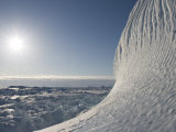 Textured Surface of Iceberg Highlighted by Sun. Pack Ice Covers Ocean Photographic Print by John Dunn