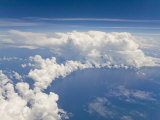 View from Airplane Window of Cumulus Clouds and Developing Thunderstorms Photographic Print by Mike Theiss