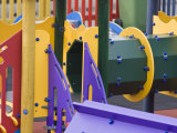 Colorful Playground Equipment in a Community Childrens' Park Photographic Print by Kent Kobersteen