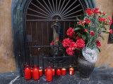 Votive Candles and Flowers Outside a Religious Shrine Photographic Print by Scott Warren