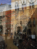 Reflection of an Italian Scene in a Glass Window Photographic Print by Gianluca Colla