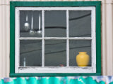 Green Framed Kitchen Window with Utensils Hanging in It Fotografie-Druck von Kent Kobersteen