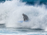 Surfer Kneels Through a Wave in the Pacific Ocean in Hawaii Photographic Print by Charles Kogod