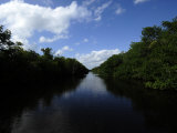 Water Channel in Everglades National Park Photographic Print by Raul Touzon